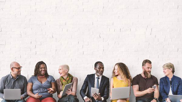 people sitting together at a wall