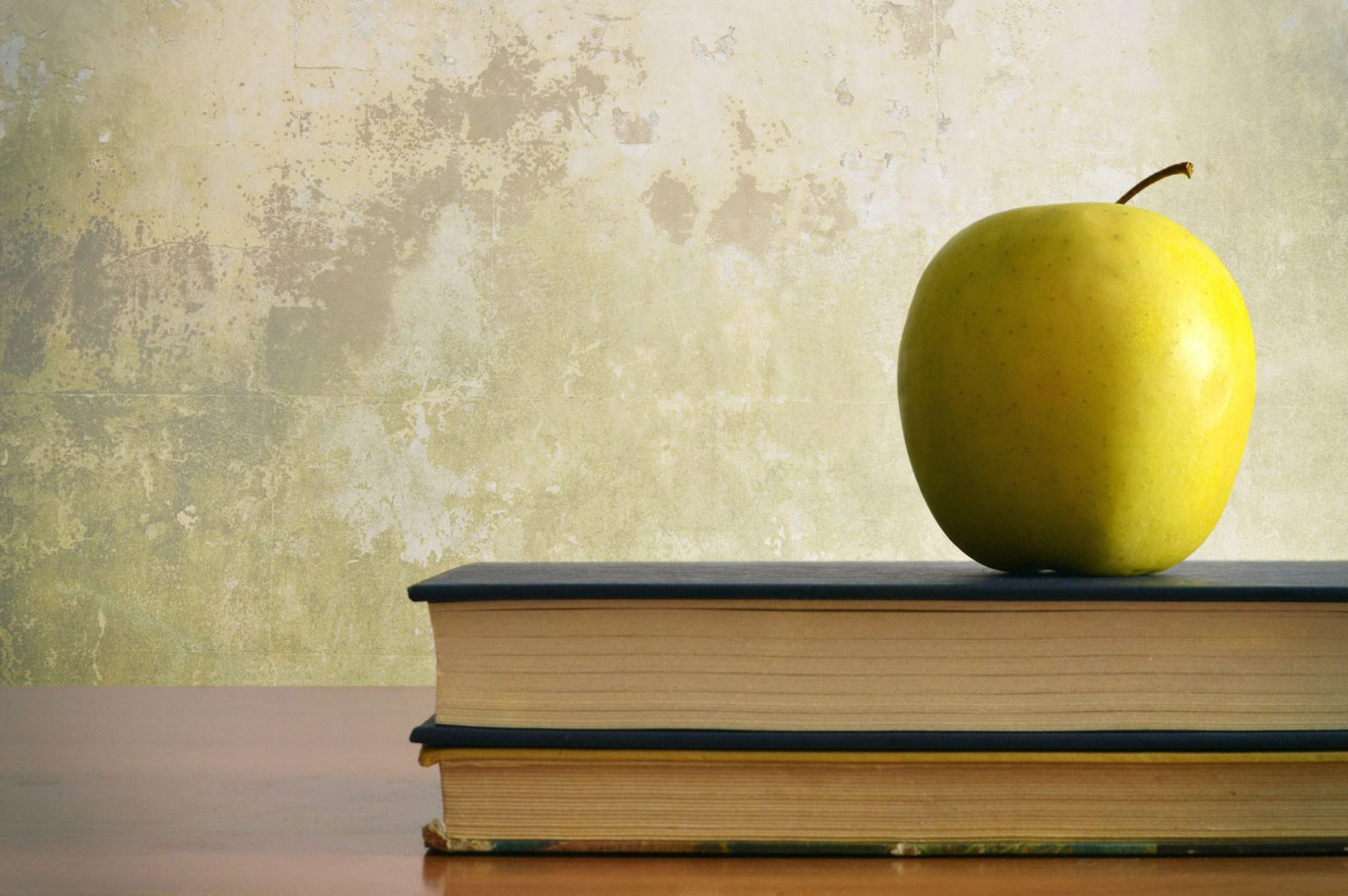 apple on top of books